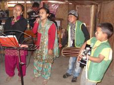 Clubbers in Nepal slum leading worship