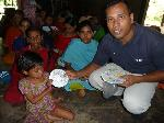 Clubber receiving Christmas ornament in Bangladesh